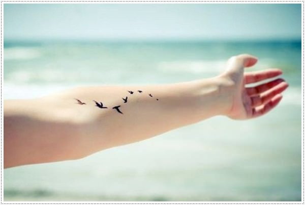 Small bird tattoos for girl on hand