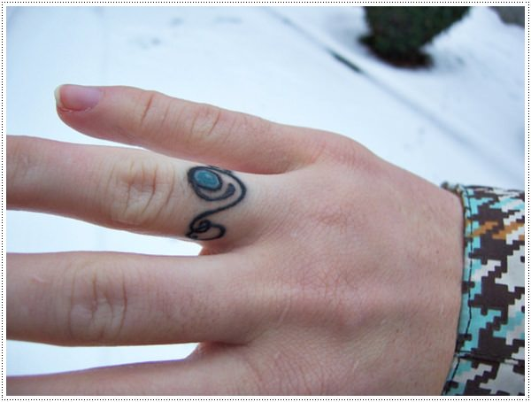 A black ring tattoos for girl