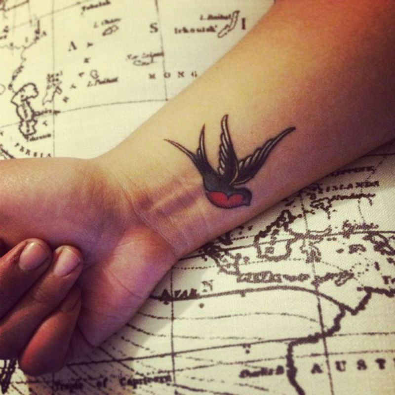 Small and beautiful coloured wrist tattoo