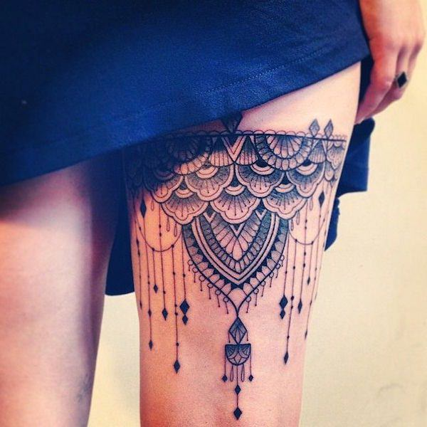 Stimulating Thigh Tattoos 11
