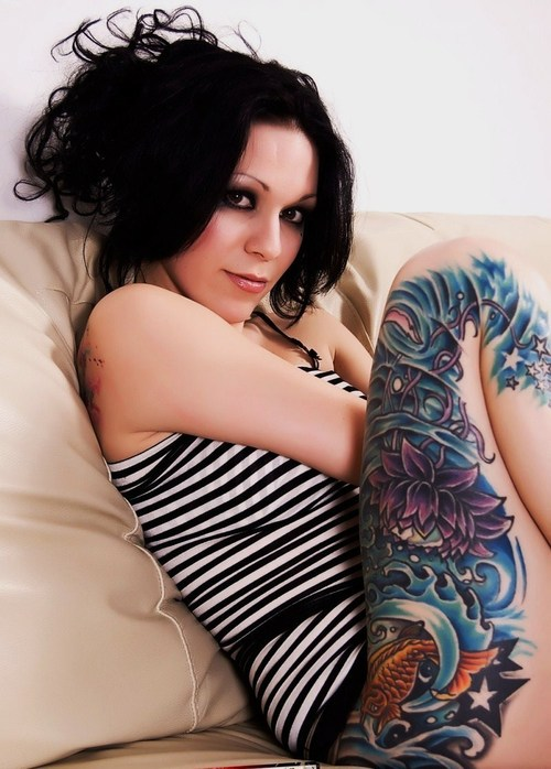 Stimulating Thigh Tattoos 63